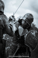 [2014-04-19@15.12.50a] (Untempered Photography) Tags: history costume fight helmet battle medieval filter weapon sword knight duotone shield combat armour reenactment champions skirmish combatant chainmail canonef50mmf14 perioddress seleniumtone platearmour gambeson mailarmour untemperedeye canoneos5dmkiii untemperedeyephotography glastonburymedievalfayre2014