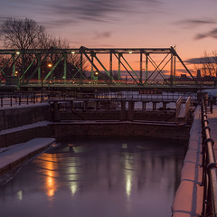 Is That January Passing By? / Janvier file en beaut (pierredamours.net) Tags: bridge winter sunset snow canada ice quebec montreal griffintown parcscanada mtlmoments