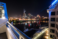 Downtown Nashville (Mark Wingfield) Tags: city bridge sky reflection water skyline architecture night john river outside outdoors lights star evening lowlight nikon long exposure cityscape waterfront nashville outdoor tennessee tripod wide pedestrian tokina adventure 16mm cumberland d610 seigenthaler