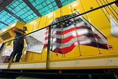 Applying the flag (Moffat Road) Tags: railroad up train paintshop ar flag unionpacific locomotive arkansas ge northlittlerock locomotiveshop scotchlite 5401 es44ac flagdecal jenksshop downingbjenksshop