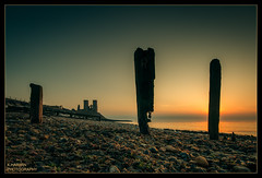 __|___|-|___|_|__ (Kevin HARWIN) Tags: blue sunset sea england sky sun building beach water stone canon lens eos kent sand rocks britain south towers sigma east 1020mm groynes reculver 70d
