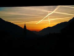 Sunset of winter. (Fabio Scalvinoni.) Tags: life blue winter light sunset shadow red sky italy panorama orange sun mountain cold church nature beautiful landscape photography photo shadows natural bell bluesky down belltower strips iphone berzo iphone365