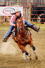 1008  Go, Go, Go! (paule48) Tags: people horse woman canada rain action fast running racing rodeo saskatchewan cowgirl determined barrelracing woodmountain