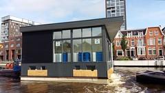 Floating house (anastigmatz) Tags: floating house houseboat eemskanaal canal groningen tugboat