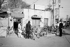Bicycle Repair Shop (gwpics) Tags: china people blackandwhite bw building history film monochrome bike bicycle person mono cycling blackwhite transport chinese beijing streetphotography lifestyle historic cycle transportation 1998  hutong  society slum socialdocumentary slums socialcomment streetpics strasenfotograpfie