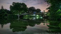 Bow Bridge (DSC01498) (Michael.Lee.Pics.NYC) Tags: lake newyork reflection night centralpark sony symmetry moonlight bowbridge voigtlanderheliar15mmf45 a7rm2