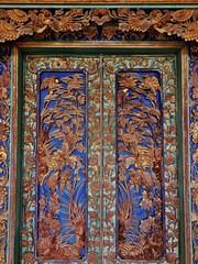 palace doors (SM Tham) Tags: flowers bali plants building birds indonesia island asia doors entrance royal palace verandah woodcarving karangasem amlapura puriagungkarangasem maskerdam