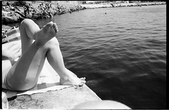 (White Heat, White Meat) (Robbie McIntosh) Tags: leicamp leica mp rangefinder streetphotography 35mm film pellicola analog analogue negative leicam analogico blackandwhite bw biancoenero bn monochrome argentique dyi selfdeveloped filmisnotdead autaut candid strangers leicaelmarit28mmf28iii elmarit28mmf28iii elmarit 28mm arsimagofd arsimagofddeveloper arsimagofd159 seaside rocks fujineopanacros fuji neopan acros woman girl legs feet soles