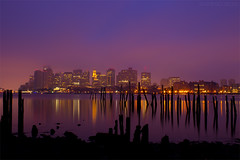 Boston Skyline Reflecting on Calm Harbor at Dawn, Carlton's Wharf East Boston (Greg DuBois Photography) Tags: ocean old city morning pink blue light sea sky urban orange usa seascape black reflection building water silhouette yellow boston fog skyline clouds skyscraper canon buildings dawn lights harbor pier seaside twilight cityscape skyscrapers purple unitedstates decay massachusetts cities newengland atmosphere overcast atlantic shore wharf citylights pilings bluehour piling eastie cityskyline waterreflection bostonskyline eastboston gregduboisphotography