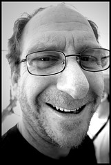 Kevin - Too Close - USS-IOWA (greenthumb_38) Tags: portrait blackandwhite bw man smile face smiling closeup beard nose glasses blackwhite eyes close teeth grin duotone 1022mm stubble canon40d jeffreybass