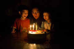 Happy Birthday~ (Alphone Tea) Tags: life family light red portrait favorite orange black cute art home beautiful smile childhood cake closeup kids night composition contrast dark print children fun happy amazing lowlight singapore asia candle bright little sweet great chinese adorable indoor livingroom age happybirthday 24 24mm lovely fullframe staring 6d 2414 2013