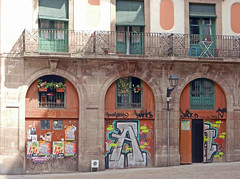 Three (Antropoturista) Tags: windows poster graffiti spain doors barceloneta balconies catalunya a