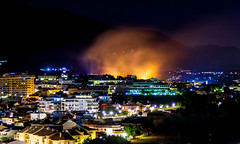 The Hills Are On Fire (k009034) Tags: city longexposure travel red mountain building beautiful night canon fire photography eos 350d town spain lowlight nightlights smoke hill nighttime rebelxt journalism fuengirola benalmadena beautifulearth