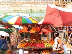 Hong Kong market under bamboo scaffolding. (ashabot) Tags: china hongkong cities streetscenes marketscenes