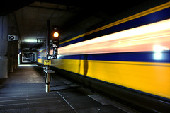 Rushing through 1 (BasLoo) Tags: blue yellow speed train moving rotterdam blauw blaak ns railway tunnel geel trein spoorwegen nederlandse vision:sunset=0635 vision:car=0787 vision:sky=0542