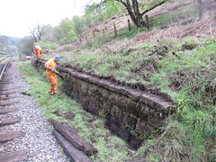 Eric, Michael and Stephen clear off the retaining wall near The Grange 14May14