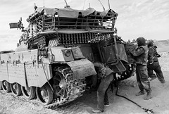 Freeze (EagleXDV) Tags: people blackandwhite bw training army fire israel sand gun tank desert exercise action military helmet gear equipment crew armor weapon soldiers armour turret idf drill cooperation afv warfare merkava
