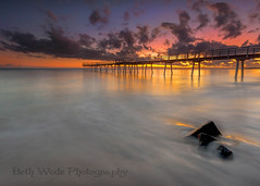 Hervey Bay Glory (Beth Wode Photography) Tags: longexposure seascape clouds sunrise canon reflections dawn pier rocks waves beth jetty le sunup herveybay daybreak slowwater wode 5dmarkiii bethwode herveybaysunrise