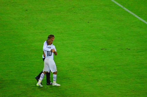 Despair, comfort and sportsmanship: Herve Renard, coach of winners Ivory Coast, puts his arm around the devastated Andre Ayew of Ghana
