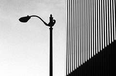 Silhouetted lamp post in front of building (Jim Corwin's PhotoStream) Tags: seattle city blackandwhite bw building lines horizontal architecture contrast outdoors photography design streetlight downtown cityscape shapes nobody line lamppost silhouetted lightanddark urbanscene buildingexterior darkspace