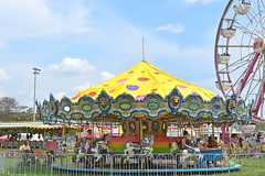 Merry Go Round (diamondzieman) Tags: park family carnival friends sky detail yellow kids fun ride bright spin lion bluesky fair event ferriswheel amusementpark kin clearsky kincarnival