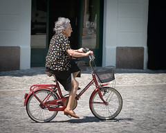 Old Lady Cyclist (James- Burke) Tags: travel tourism shopping movement cyclist action candid cycle italycolour oldladycyclist