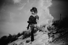Head in the clouds... (privizzinis passion photography) Tags: ocean boy sea people blackandwhite beach monochrome childhood clouds hair children fun outside outdoors jump sand child play outdoor doubleexposure joy