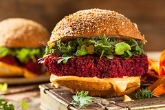 Healthy Baked Red Vegan Beet Burger (brent.hofacker) Tags: red food brown green vegetables tomato bread lunch pepper wooden salad vegan healthy raw sauce burger wheat rustic tasty vegetable sandwich fresh gourmet delicious lettuce health homemade american snack hamburger meal vegetarian beets quinoa veggie diet beet grilled patty beetroot bun spinach beetburger veganburger