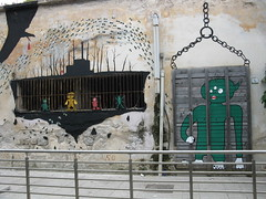 11/6 squad: the cage (tonitonim) Tags: sardegna street urban muro verde green art wall chains eyes strada arte alien bee occhi jail ape 116 cge olbia sardaigne gabbia sardigna tonim tonitonim prigionne