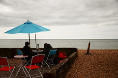 DSC_3816 we will enjoy the day (rayholden15) Tags: cold beach umbrella outside stones colouredchairs