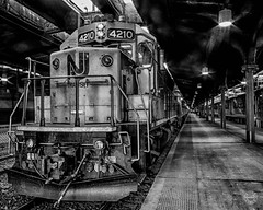 The 7:57 to Port Jervis (brianloganphoto) Tags: blackandwhite bw monochrome newjersey nj trainstation historical locomotive hoboken commuters landcape castironarchitecture njttrain landmarkironore