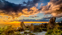 At the Going Down of the Sun (MyWorldThroughMyLens) Tags: sunset england grass backlight clouds standingstones rocks glow cheshire unitedkingdom outdoor heather illuminated gb backlit lowsun mowcop cloudsstormssunsetssunrises longvista
