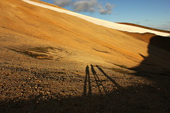 Everything that we see is a shadow... (Freyja H.) Tags: iceland mskarshnjkar geology scree rhyolite shadow rhinocerus nature landscape outdoor hill mountain mountainside snow rock gravel