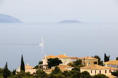 Sailing boat crossing the Saronic Gulf, Greece (Yannis Raf) Tags: blue sea seascape canon boat sailing greece greeklandscape canoneos70d efs18135f3556isstm saintaemilianus staemilianus