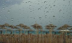 The storm began (Argyro...) Tags: beach glass rain umbrella drops greece pane chalcis   alykesdrossias