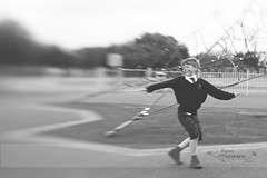 """The healthiest response to life is joy."" -  Deepak Chopra (k4wea) Tags: park bw motion blur childhood playground lensbaby fun child artistic joy laughter 129 composer dailyishphoto"