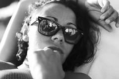 girl on beach (gorbot.) Tags: portrait blackandwhite bw beach sunglasses f14 roberta wayfarer rayban marbella canoneos5d nikonfmount planar5014zf silverefex carlzeisszf50mmplanarf14 eosadaptor