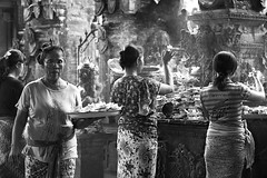 Morning ritual (Andrew Tan 2011) Tags: bali flower stone indonesia temple four women market smoke traditional atmosphere carving blessing offering gods tray ritual smoky tradition carry incense pasar ubud bespectacled sarung matchpointwinner thepinnaclehof mpt314 tphofweek235