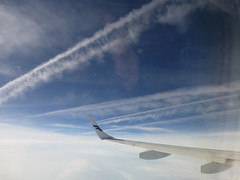 Across the vapour trails (seikinsou) Tags: finland airplane spring helsinki flight wing finnair aeroplane vapourtrail flybe
