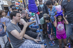 Joy in simple things... (ashu_g) Tags: streetphotography downtowntoronto 22mm buskerfestival canonm