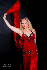 Breagh's Belly dance with wrap (Alex t Kyle) Tags: lighting red black colour beautiful female hair studio happy dance model long pretty dress arms bright joy vivid wrap dancer skirt entertainment exotic fabric blonde mysterious bellydance form delicate shoulder performer lowkey modelling poise throw kpcccrit alexkylephotography