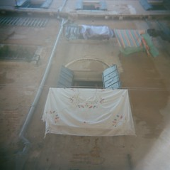 air out (kate_elizabeth) Tags: venice italy 120 film holga lomo july laundry shutters 2013