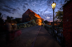 Tumski Bridge at dusk (Photos On The Road) Tags: road old city bridge sunset urban church horizontal outside outdoors evening twilight streetlight europa europe tramonto mood arch outdoor steel poland illuminated ponte cobblestone chiesa arco polonia wroclaw lampione silesia breslau outdoorshots orizzontale breslavia outdoorshot tumskibridge slesia slesien viaggiosettembre2013