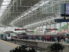 Commuters at Beijing North Railway Station (mikecogh) Tags: roof architecture train design beijing platform engine railwaystation beams commuters