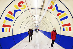 Colourful London, (Sean Hartwell Photography) Tags: city blue red people london smile yellow colours tube tunnel commuting londonunderground kingscross stpancras primary