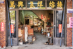 The little shop of Curiosities (gullevek) Tags: door building sign shop wall trash writing fuji taiwan jp taichung tw         taichungcity  fujixt1 fujinonxf1855mmf28f4rlmois