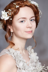 Portrait of beautiful red-haired bride. She has a perfect pale skin with delicate blush. White flowers in her hair. She smiles gently. She has light gray eyes. (noor.khan.alam) Tags: flowers wedding white mist holiday color cute green love girl beautiful beauty smile face loving youth hair studio bride ginger spring skin blossom softness gray dream young ukraine romance redhead celebration wreath romantic wildflowers bouquet lovely bridal blush sensuality hairstyle celebrate tender tenderness freshness braid elegance purity femininity redhaired