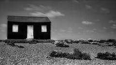 """""""Tin Shed"""" (opshorton) Tags: longexposure sky blackandwhite beach clouds canon tripod rye 7d eastsussex manfrotto ryeharbour seakale tinshed canon7d"""