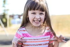 Grrrrrrr! (Vegan Butterfly) Tags: portrait silly cute girl face outside person kid vegan funny child dinosaur outdoor teeth adorable growing growl pretend pretending