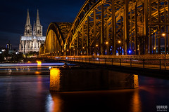 Dom Cathedral and Hohenzollern Bridge (davidgevert) Tags: longexposure bridge church water river germany twilight europe cathedral dusk cologne kln d750 bluehour rhineriver colognecathedral hohenzollern travelphotography hohenzollernbrcke domcathedral hohenzollernbridge nightcityscape nikon2470mmf28 europeancityscape davidgevert gevertphotography nikond750